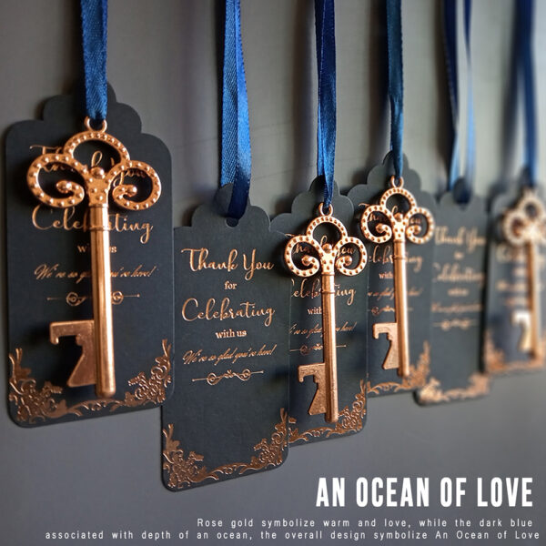rose gold key bottle opener with deep blue tag